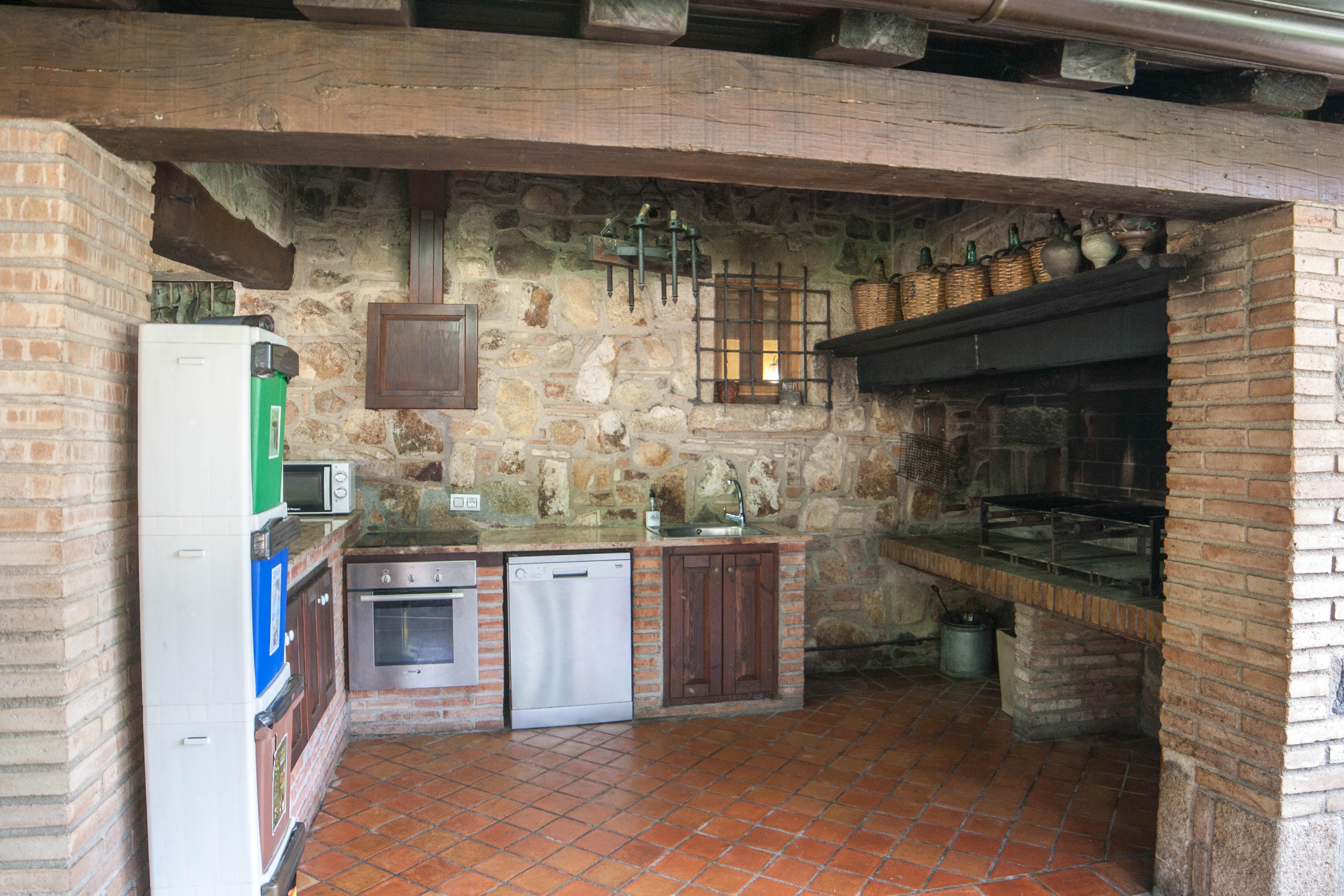 Galer a de fotos de villa la belladona porche - Porches con barbacoa ...